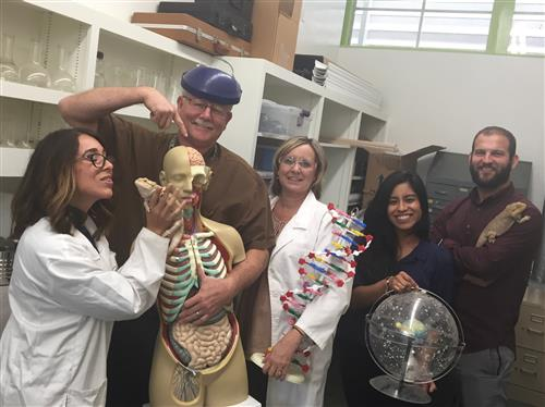 Science teachers with props and pets