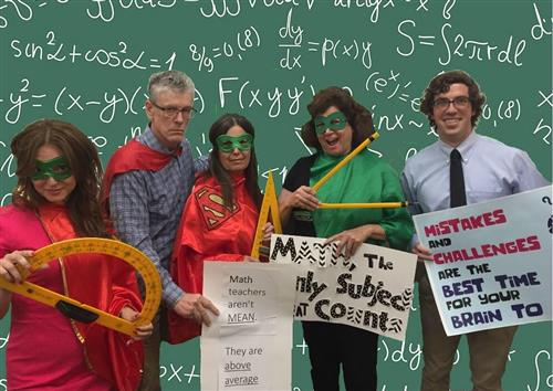 Math teachers in masks and capes.