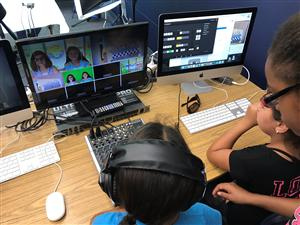 Students working on video production